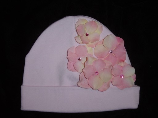 Pink infant beanie cap with pink hydrangea flower petals
